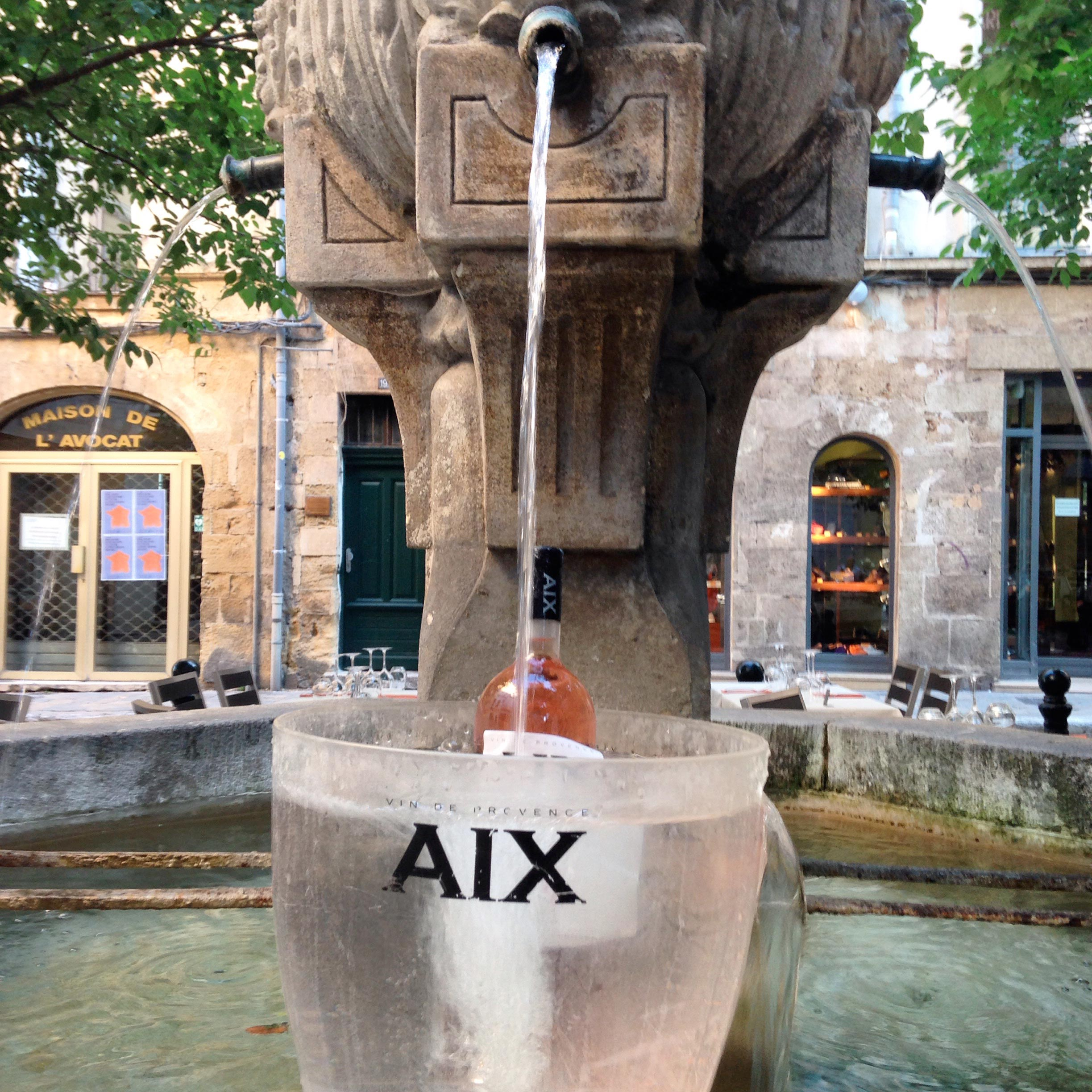 Provence wine tour, fountain with rosé bottle in Aix en Provence