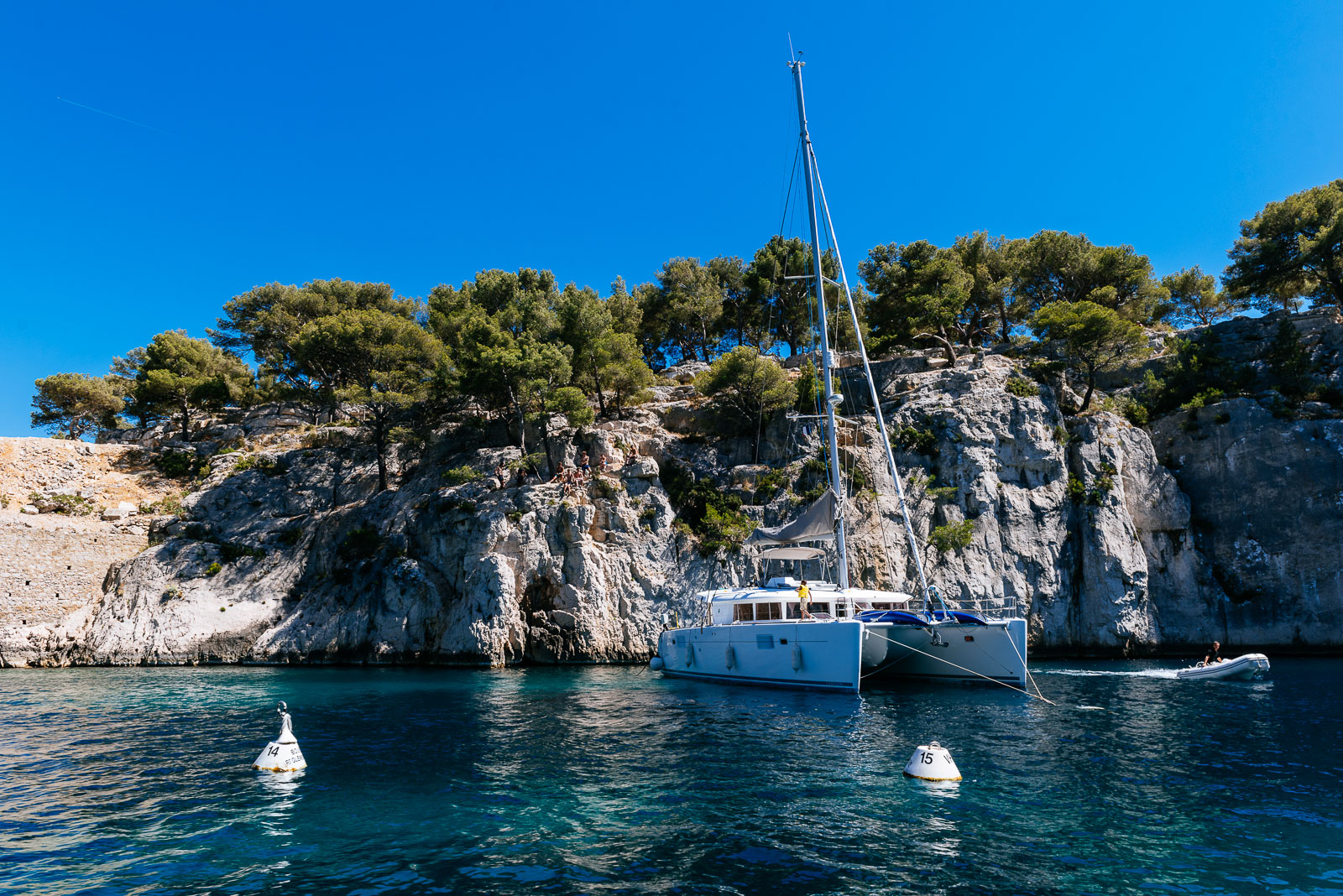 Wine and sailboat, catamaran in calanque