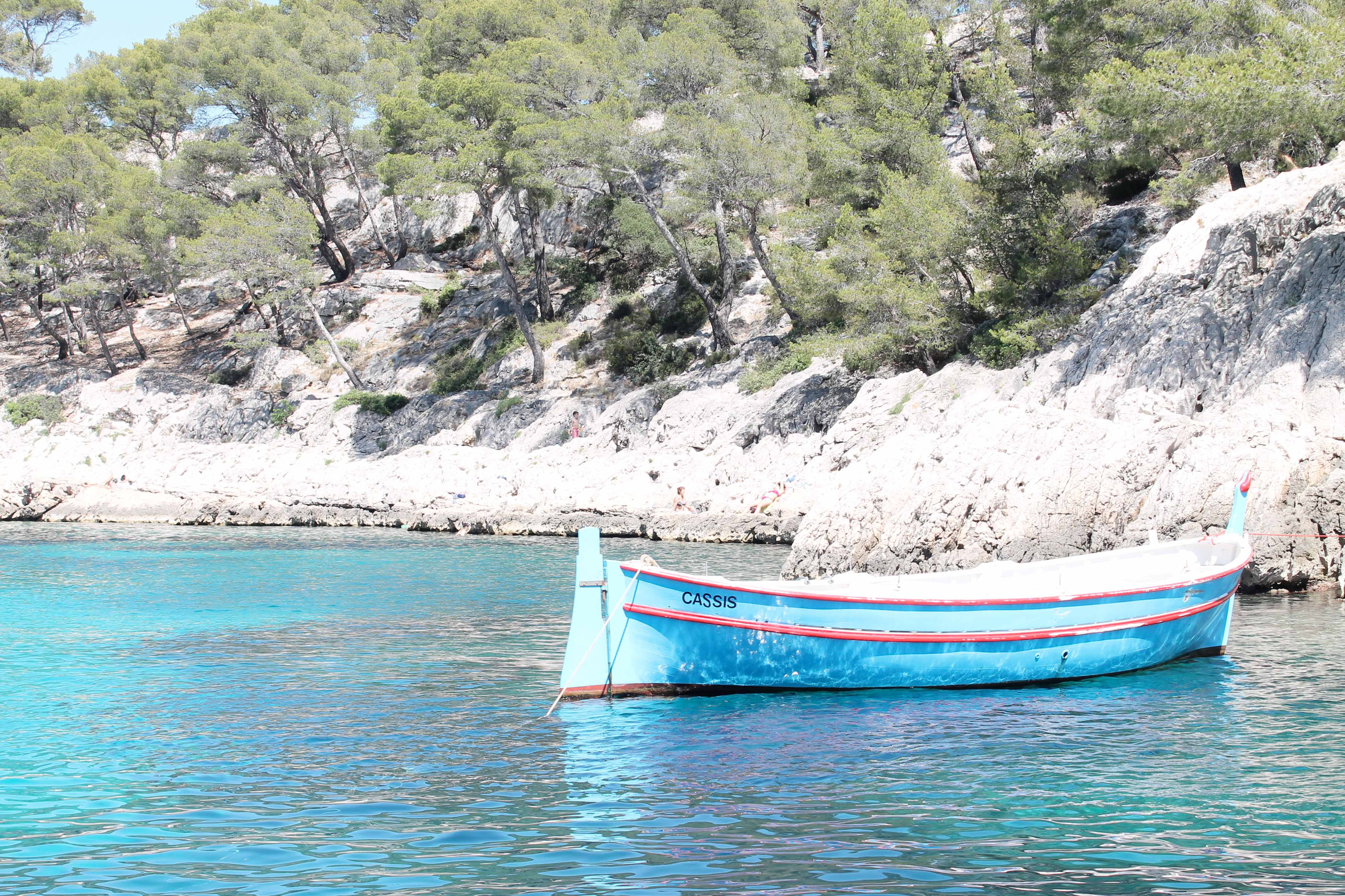 Wine and sailboat, fisherman boat in the calanques