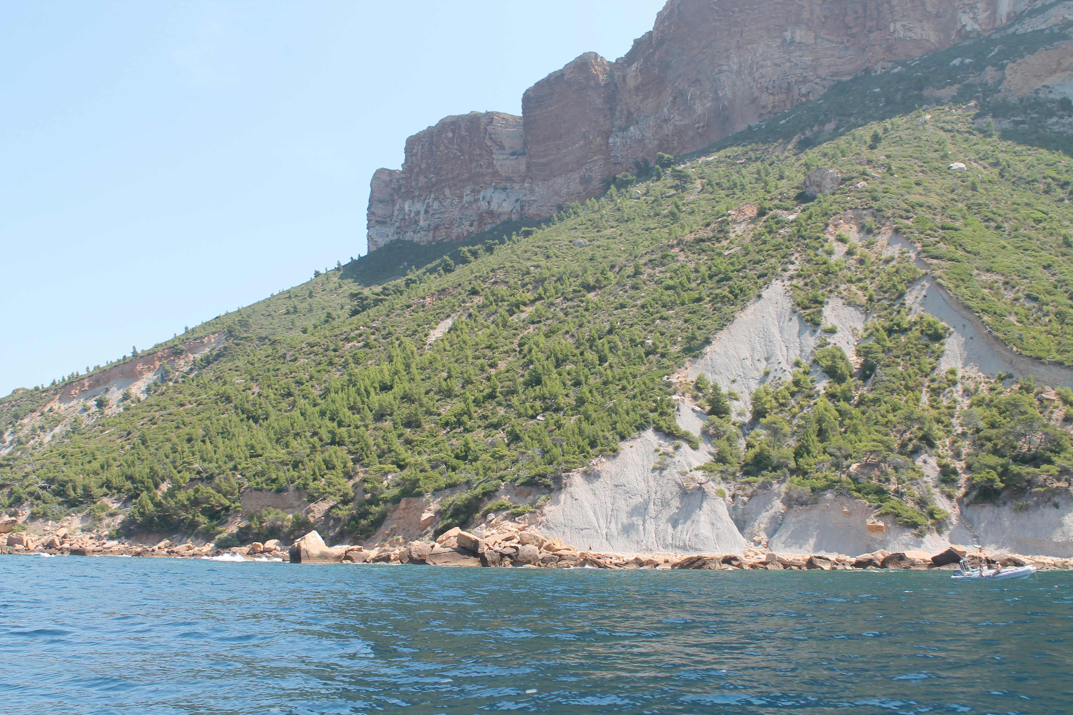 Wine and sailboat, cliffs near Marseille