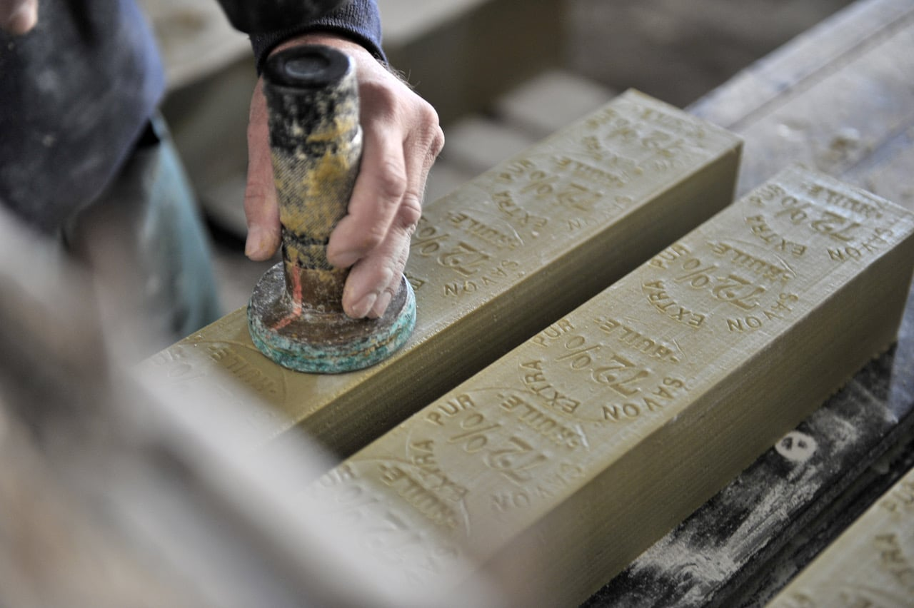 """Marseille soap """"Savon de Marseille"""" at the factory, stamping and marking"""